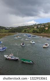 San Vicente de la Barquera,Spain; 08 15 2017: The boats stand in the harbor with calm waters in San Vicente de la Barquera