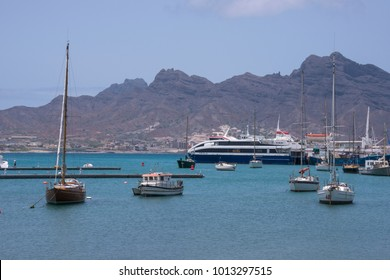 San Vicente island, Cape Verde - august 28, 2015: Sailboats and pleasure boats, with ferries in the background, in the bay and port of the historic city of Mindelo