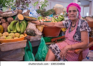San Vicente island, Cape Verde - september 29, 2015: Old woman in her grocery stand at the Municipal Market in the urban center of the city of Mindelo