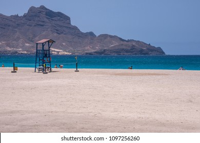 San Vicente island, Cape Verde - september 29, 2015: Watchtower and Laginha beach on the coast of Mindelo, capital of the island, in a sunny day