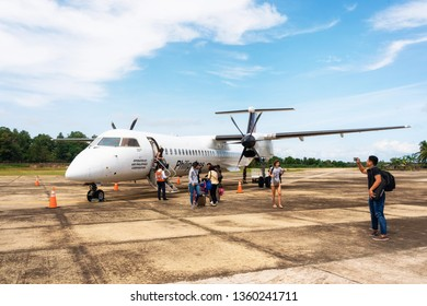 San Vicente, Philippines - January 30, 2019: Travellers leave Bombardier Q400 airplane Philippine Airlines at new small Airport in Palawan Island.
