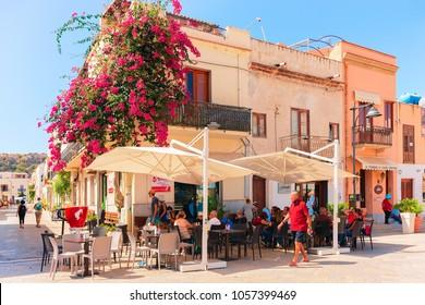 San Vito lo Capo, Italy - September 17, 2017: People at sidewalk cafe in San Vito lo Capo, Sicily, Italy