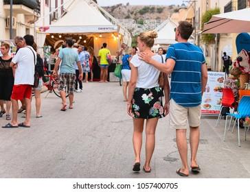 San Vito lo Capo, Italy - September 16, 2017: Young couple at the street market in San Vito lo Capo, Sicily, Italy
