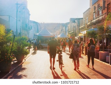 San Vito lo Capo, Italy - September 17, 2017: People with bicycle in the street of San Vito lo Capo, Sicily, Italy