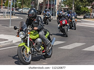 "SAN VITTORE, FC,  ITALY - JULY 15: unidentified biker riding a italian motorcycle Moto Guzzi V11 Sport at rally ""VIII weekend Moto Guzzi"" on July 15, 2012 in San Vittore (FC) Italy"