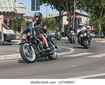 "SAN VITTORE, FC,  ITALY - JULY 15: unidentified biker riding a vintage italian motorcycle at rally ""8�° weekend Moto Guzzi"" on July 15, 2012 in San Vittore (FC) Italy"