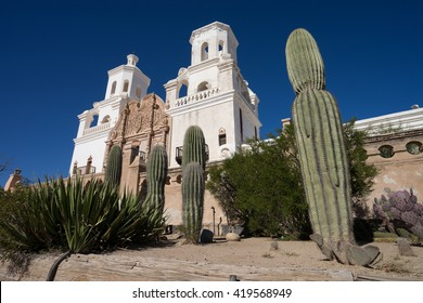 the san xavier del bac mission wit saguaros in front in tucson arizona usa