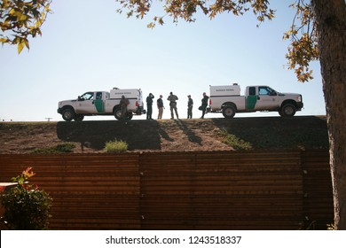 San Yasidro, California - 11/26/2018: Border patrol agents discuss their next moves and survey the landscape at the US Mexico Border. Government and Border agents are all on High Alert.