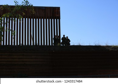 San Ysidro, California - 11/26/2018: Border fence between the USA and Mexico including New Construction adding an additional layer of fencing and razor wire or barbed wire to secure the border.