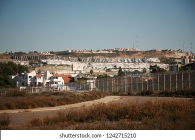 San Ysidro, California - 11/26/2018: Views of Tijuana, Mexico across the fence border of the USA/Mexico border. Tensions are high due to the Migrant Caravan threatening to stampede the us border.