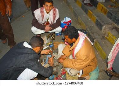 SANAA, YEMEN, JANUARY 2009: Unidentified men deal with janbiyas at the Bab al-Yaman bazaar on January 4, 2009 in Sanaa, Yemen