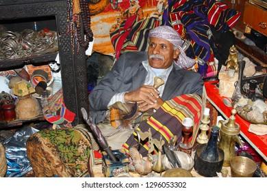 SANAA, YEMEN, JANUARY 2009: unidentified man selling Antiques at the Bab al-Yaman bazaar on January 5, 2009 in Sanaa, Yemen