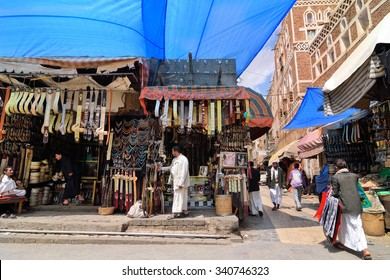 SANAA, YEMEN - MAR 6, 2010: Typical street scene in old city of Sanaa. Inhabited for more than 2.500 years, the Old City of Sanaa is a UNESCO World Heritage City now destroyed by the civil war