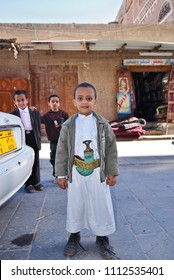 Sanaa, Yemen - March 12, 2010: Unidentified yemeni little boys in traditional clothes shown at street in Sanaa