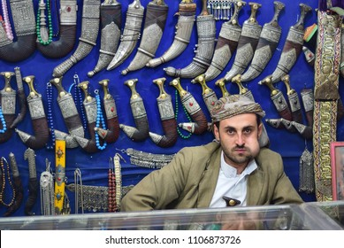 Sanaa, Yemen - March 13, 2010: An unidentified man sells janbiyas in Sanaa. Janbiya is a traditional knife that yemeni men typically above the age of 14 wear it as an accessory to their clothing