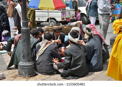 Sanaa, Yemen - March 6, 2010: Street scene in capital of Yemen, Sanaa showing  a local men having lunch.  Among other arabic countries, in 2012 Yemen became a site of civil conflicts
