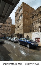 Sanaa, Yemen - March 6, 2010: Very rare weather phenomenon - rain on the street in old city in Sanaa. Inhabited for more than 2500 years at an altitude of 2.200 m Sanaa is a UNESCO World Heritage City