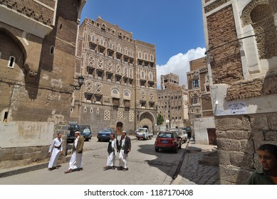 Sanaa, Yemen - March 6, 2010: Typical street in old city of Sanaa. Inhabited for more than 2500 years at an altitude of 2.200 m, the Old City of Sanaa is a UNESCO World Heritage City