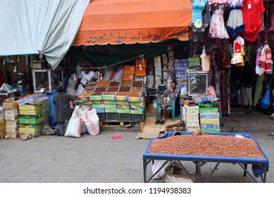 Sanaa, Yemen - March 6, 2010:  Unidentified men sell goods on the street market. Open markets play a central role in the social-economic life of one of the poorest countries in the Arab World