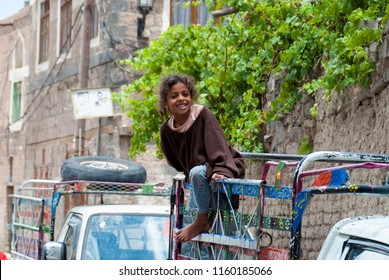 Sanaa, Yemen - May 4, 2007: A girl on a vehicle smiles at the camera. Although infant mortality is high, children in Yemen are culturally, socially and religiously value