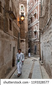 Sanaa, Yemen - May 4, 2007: A young man in traditional clothes walks in the narrow streets of the city. The Old City of Sanaa is a UNESCO World Heritage City.