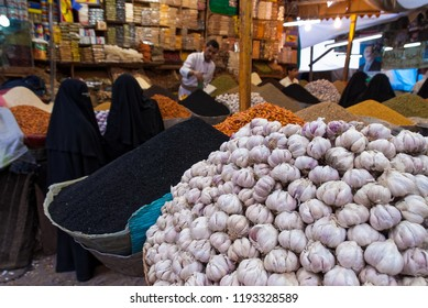 Sanaa, Yemen - May 4, 2007: A man sells spices in an open market. Open markets play a central role in the social-economic life of Yemen, one of the poorest countries in the Arab World.