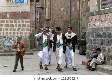 Sanaa, Yemen - May 4, 2007: A group of young men walk in a street, wearing their traditional knives janbiyas