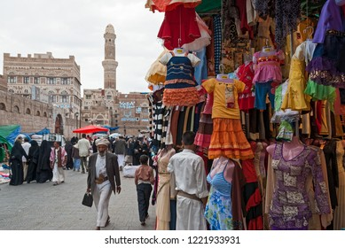 Sanaa, Yemen - May 4, 2007: A man sells colorful dresses for little girls. Open markets play a central role in the social-economic life of Yemen.