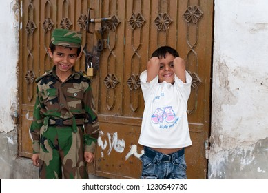 Sanaa, Yemen - May 4, 2007: Two happy boys smile to the camera in front of the door of their house. Although infant mortality is high, children in Yemen are socially valued.