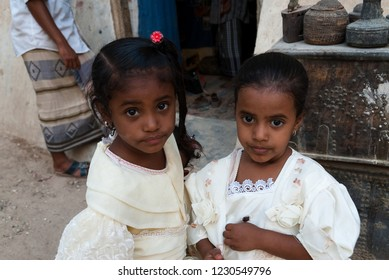 Sanaa, Yemen - May 4, 2007: Two girls in white clothes pose to the camera. Although infant mortality is high, children in Yemen are socially valued.