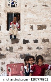 Sanaa, Yemen - May 4, 2007: A group of children pose at the camera outside a house. Children in Yemen are culturally and socially valued.