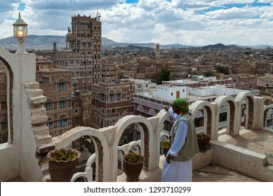Sanaa, Yemen - May 4, 2007: A man in traditional clothes admires the cityscape. The old town of Sanaa is a UNESCO World Heritage City.