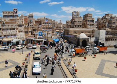 SANAA, YEMEN - SEPTEMBER 09, 2006: Unidentified people walk by the street of the city in Sanaa, Yemen. The old city of Sanaa is a UNESCO World heritage site.