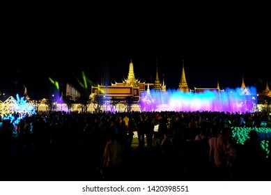 Sanam Luang, Bangkok, Thailand - May 2019 : People are enjoying the light and sound display on the dancing water fountain at Sanam Luang during the celebration of the coronation of King Rama X.
