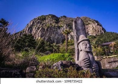 Sanbangsan Mountain with dol hareubang  at Jeju Island, South Korea.