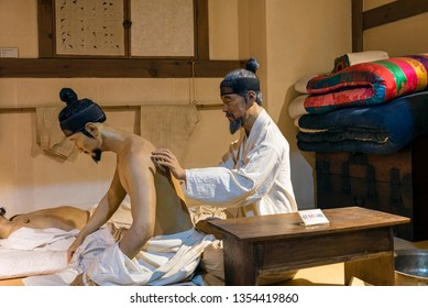 Sancheong, South Korea - March 9, 2019: A model showing the treatment of patients in an oriental medical clinic. This is displayed in the Oriental Medicine Museum in Donguibogam Village.