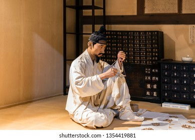 Sancheong, South Korea - March 9, 2019: A model showing the preparation of medicine in oriental medical clinic. This is displayed in the Oriental Medicine Museum in Donguibogam Village.