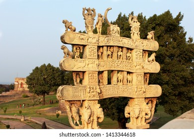 Sanchi, Bhopal, India - Jan 22, 2017: Carved decoration of the Northern gateway to the Great Stupa of Sanchi with golden light at sunset and blue sky.