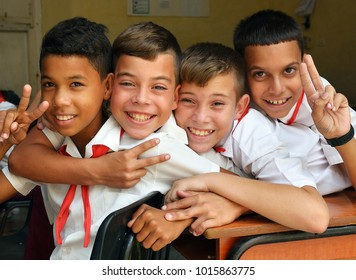 Sancti Spiritus, Cuba - February 09, 2015. Happy Cuban pioneers in school.