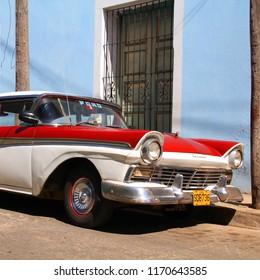 SANCTI SPIRITUS, CUBA - FEBRUARY 6, 2011: Classic American car is parked in the street in Sancti Spiritus, Cuba. Cuba has one of the lowest car-per-capita rates (38 per 1000 people in 2008).