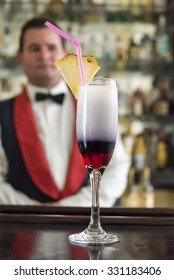 SANCTI SPIRITUS,CUBA-SEPTEMBER 19,2015:Growing wine culture in Cuba: Cocktail drink served in a champagne glass with straw and pineapple slice at a bar in Sancti Spiritus, Cuba.