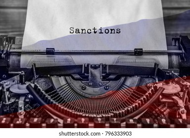 Sanctions, a printed word on an old vintage typewriter. background flag of russian federation