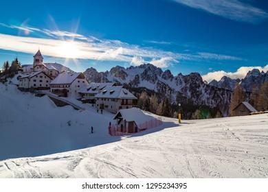 The Sanctuary of Lussari between the peaks of Tarvisio in the italian alps