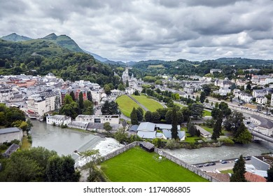 The Sanctuary of Our Lady of Lourdes or the Domain and river Gave de Pau. The Hautes-Pyrenees department in the Occitanie region in south-western France