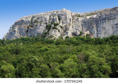 Sanctuary of Sainte-Baume installed in a cave at the foot of the cliff, above the national forest. - Shutterstock ID 1707341245