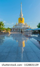 The sanctuary, temple, with blurred the shadow the blue sky cloud.The public properties at Wat Phra That Na Dun, Sarakham province, Thailand.