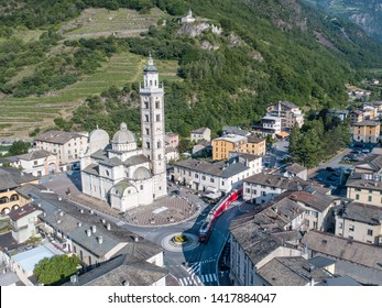 Sanctuary of Tirano and red train of Bernina Express. Tourism in Valtellina