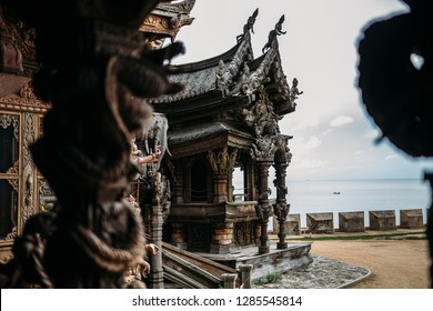 Sanctuary of Truth is a temple construction in Pattaya, Thailand. The sanctuary is an all-wood building filled with sculptures based on traditional Buddhist and Hindu motifs.
