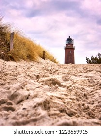 Sand away to the lighthouse, Darsser place on the Baltic Sea. Germany