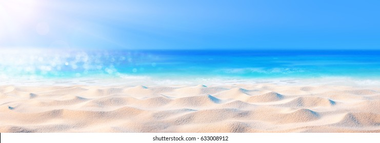 Sand Background With Sea And Sunlight